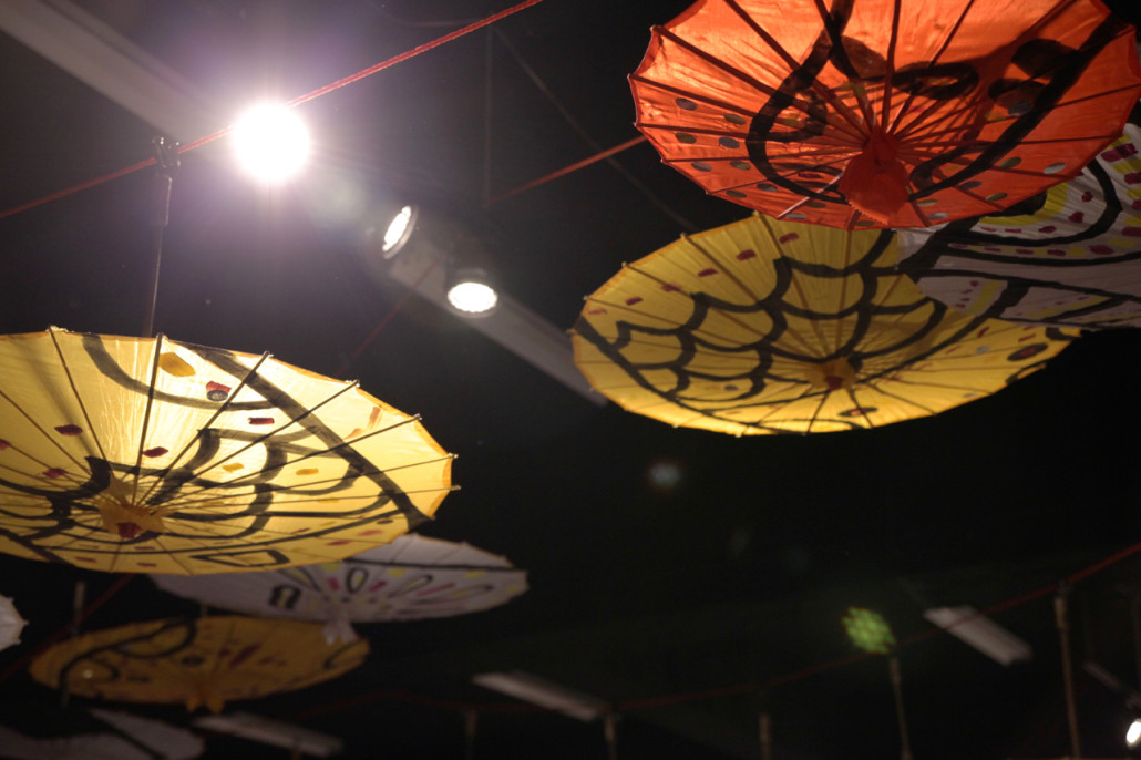 Bara's umbrellas hung festively across the Red Room's ceiling